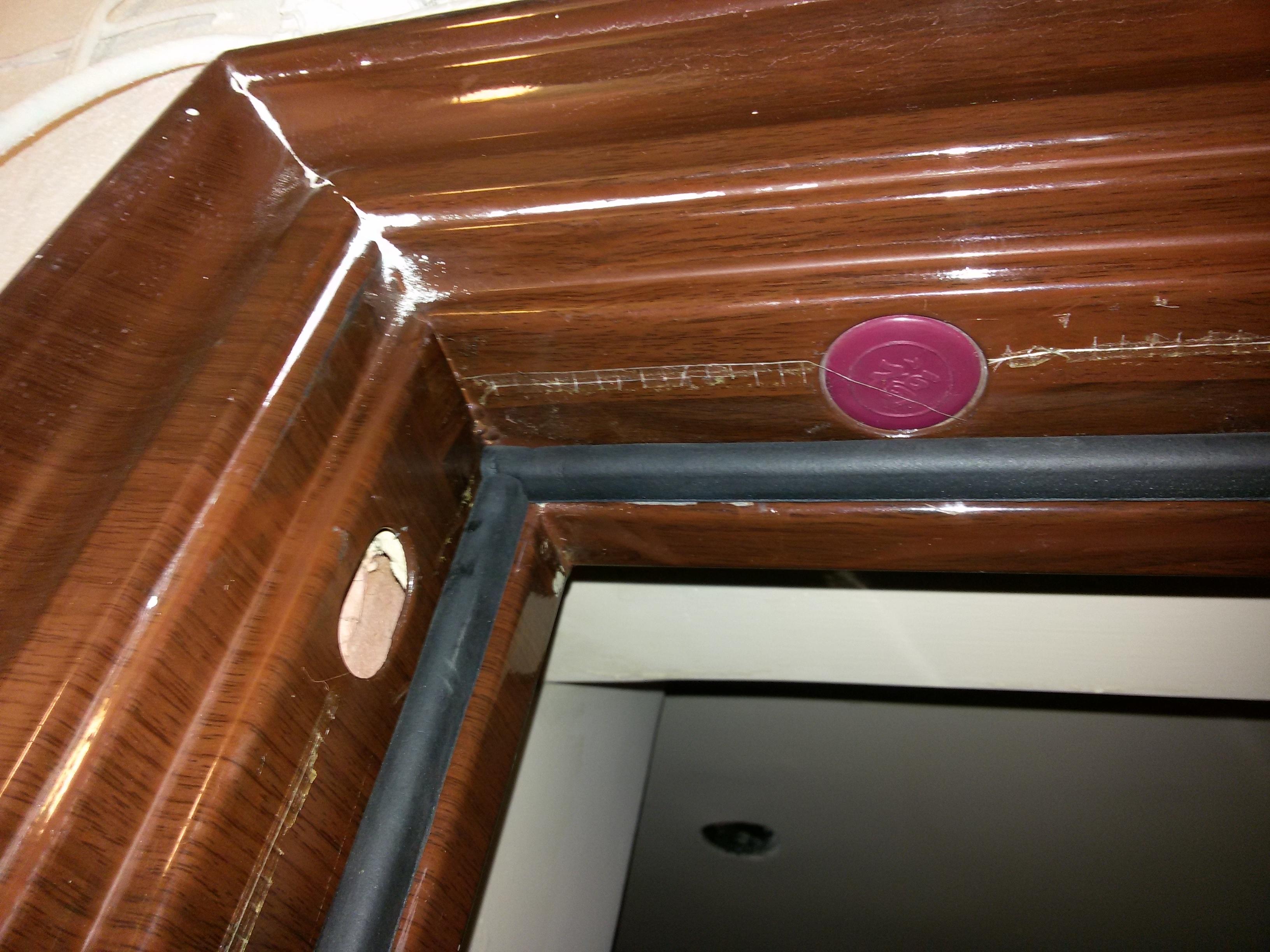 Фото Утепление дверей путём регулировки всех зазоров двери и наклейки уплотнителя (Германия).